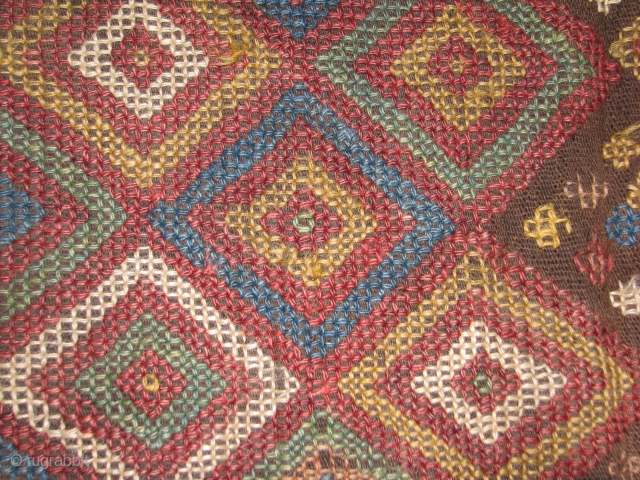 This is a flatweave fragment with all natural colors,as found. Some parts the worn out spots can be restored easily,restoration available on all kind of handmade rugs