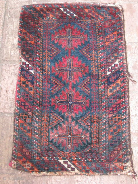 Here is an old baluch balisht with nice blue green background very soft silky wool all natural colors,it still has the backing