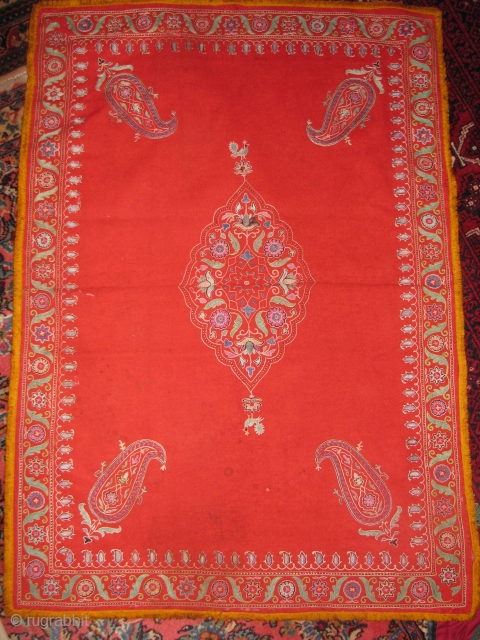 Here is an old kerman suzani with all natural colors and good condition it does have a very tiny stain that i believe shouldn't be hard to get it clean