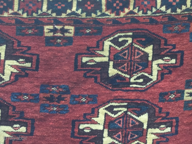A full pile Yomut or Karadashli Turkmen Chuval (detail).115x77cm. Minor damage in one or two small areas. 19th Century or earlier.