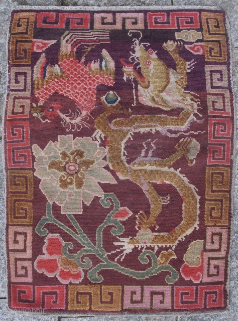 This quirky Tibetan sitting or saddle top rug (Khagangma) shows a unique combination of colour and expressive design. Circa 1920. 82x60cm.