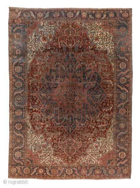Heriz Carpet  10.3 x 14.1 3.13 x 4.29  An unusual green bent leaf and rosette border tonally matches  the large, elaborately pendanted, strapwork medallion. Quasi-three dimensional strapwork is repeated in the ivory corners. The  ...