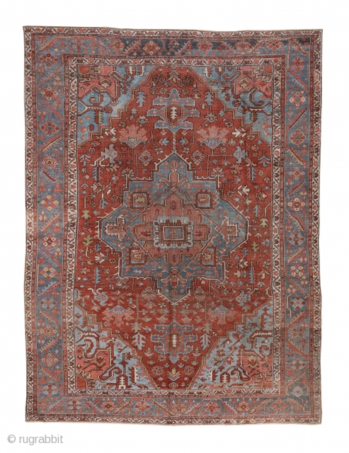 Heriz Carpet  9.8 x 12.9 2.98 x 3.93  We might term this a 'Serapi', but 'Heriz' will do. This rural NW Persian carpet presents a green octogramme medallion with tonally matching ragged palmette pendants on  ...