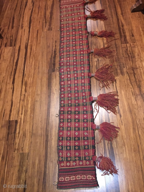 "Baluch trapping, 72""x11"" . First 1/2 20th C. All wool. Natural colors. Goat hair edge wrapping. Decorative tassels. Weft substitution weave. Nearly perfect condition."