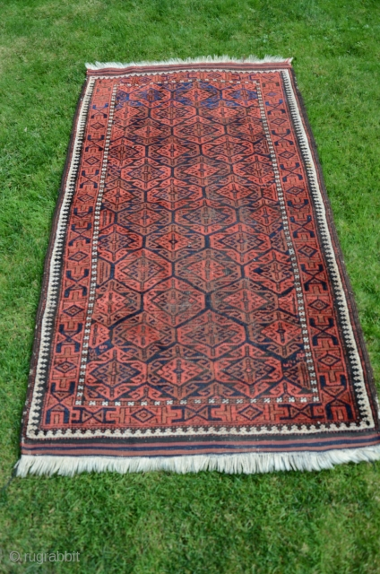 """Baluch pile rug. 5'1"""" X 2' 10"""". Wool. Circa 1900. Natural colors. Good pile. Excellent original condition with retained kilim ends and selvedges in good condition."""