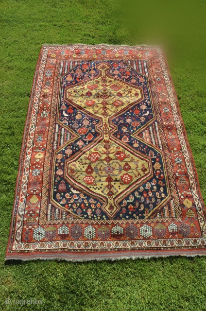 """Khamseh Confederacy pile rug 50"""" X 81"""". 19th C. Wool. Strikling design and beautiful border. Bright saturated natural dyes including a warm yellow. . Full luscious pile. Original finishes including kilim ends.  ..."""