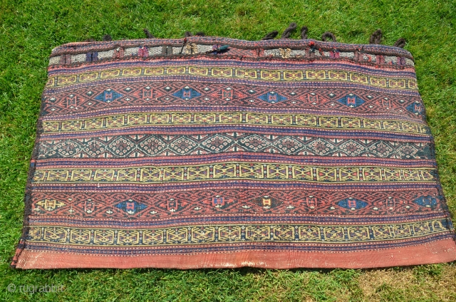 "Afshar flat woven rakkat  (large storage bag) 52-1/2"" X 31-1/2"". Early 20th C. Patinated natural dyes. Weft substitution faces in wool; partly striped plain woven back. Minor signs of tribal use.  ..."