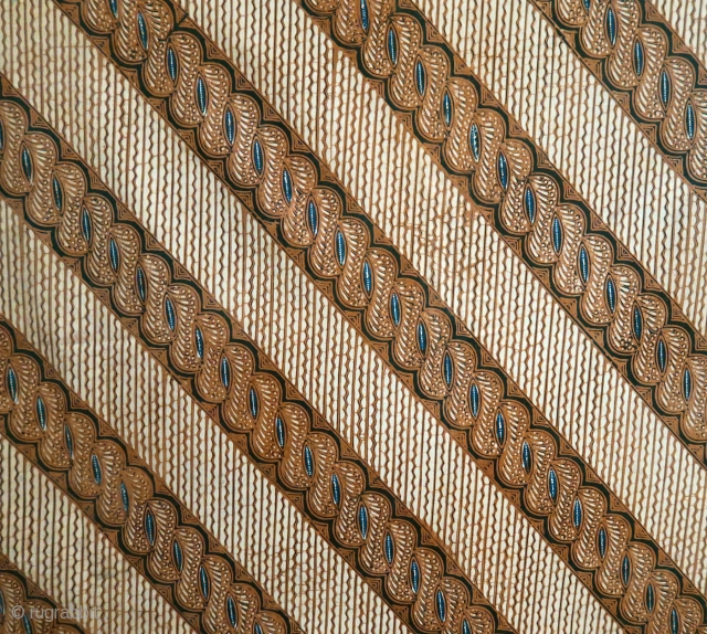 Java | early hand drawn batik waist wrapper  Indonesia, Java, Solo, second quarter of 20th century  Commercial cotton, botanical indigo and soga dyes, batik tulis (hand drawn batik)  A graceful, sophisticated batik, hand-drawn in the  ...