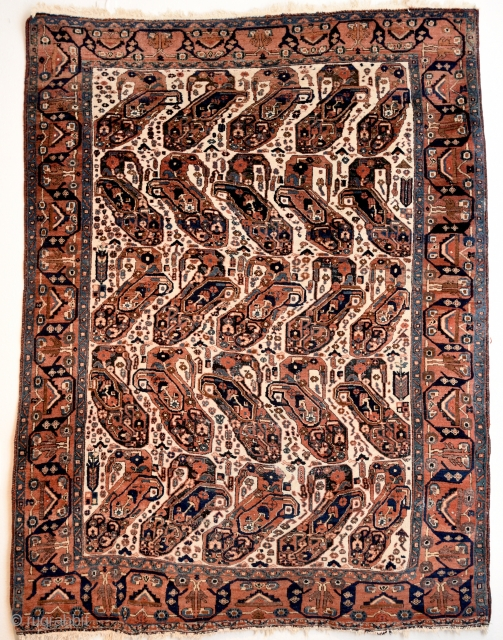 An early 20th century Afshar with mother and child boteh pattern. All natural colors. Size: 194cm x 151cm.