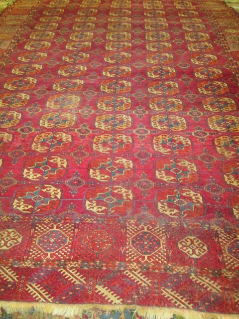 Antique Tekke Turkoman Rug.  size 11'4'' x 7'9''. condition very good for the age ,low even pile with one small spot lower then other part of the rug.  needs a bath.fine quality  ...