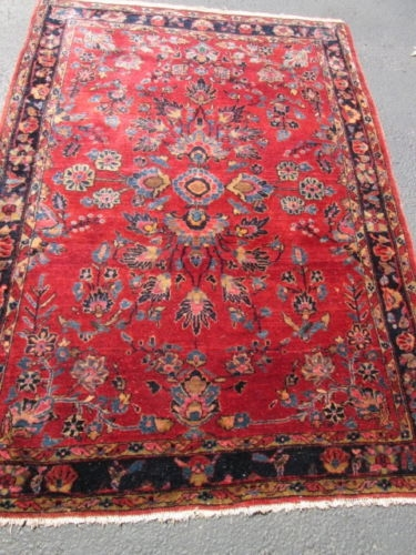 Antique Persian Mohejaran sarouk rug.