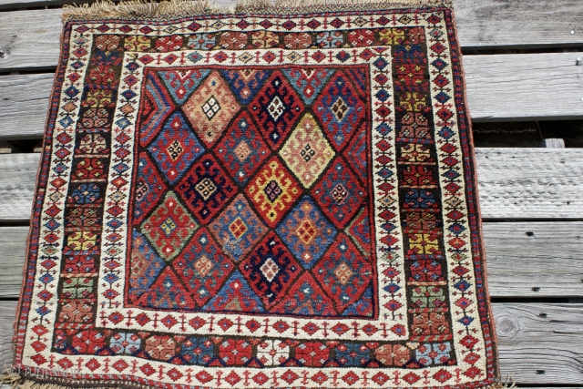 "Early 20th century Persian Jaff Kurd diagonal hooked diamonds single bag face without back, size: 2'9"" x 2'6"".  Small rewoven spot otherwise in excellent condition.  Top and bottom end in  ..."