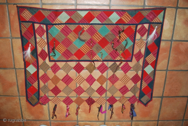 Old Turkmen animal trapping, 84 x 118 cm, rather good condition, made from silk and woollen fabrics, backed with block printed fabrics