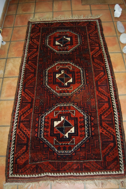 Old Baluch rug with three large Salor guls, 102 x 185 cm without fringes, rather good condition with full pile, cleaned/washed, natural colours