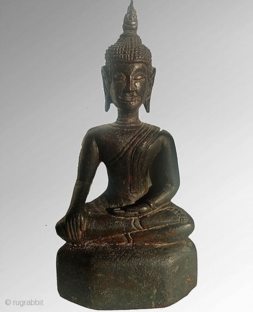 Thai lacquered wooden Buddha 26.00x 12cm Calling the earth to witness. Depicted with long flaming usnisa, long ears, and eyes closed. Sutras inscribed on the base Provenance: acquired from U.K private collection POA