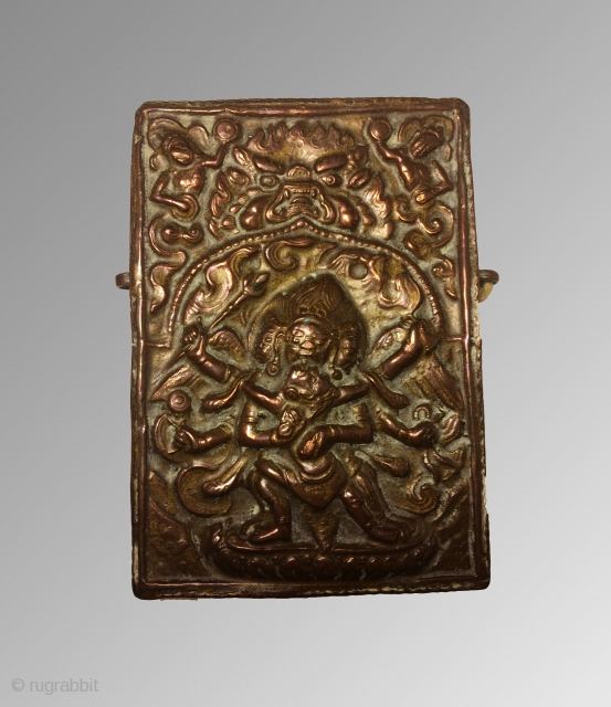 Tibetan travelling shrine of the deity most likely to be Vajrakilaya Vajrakila has three faces, six hands, four legs and wide outstretched wings behind. He embraces the consort Dipta Chakra who has one  ...