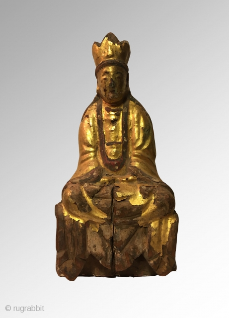 Chinese lacquered Guanyin in meditation 22cm x 11cm  19th Century or earlier  Condition: As seen, lacquer has flaked off in areas giving the piece a beautiful sense age to it. Wood has split  ...