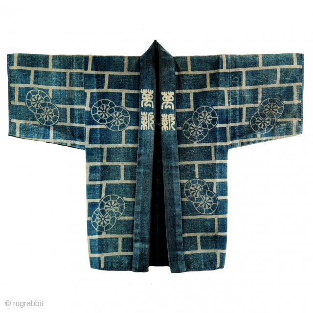 Sashiko Banten - Japanese Fireman's Jacket  Antique Japanese fireman's jacket with sashiko stitching - hikeshi banten.   Indigo cotton katazome brick wall motif with ox cart wheels (Gissya) kamon.  Typically these jackets were soaked before  ...