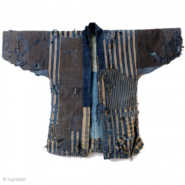 A tattered and stunning Japanese boro work jacket, or noragi.   Layers of shima striped cottons give way to more stripes.   Suitable for display or wear, this is one of our favorite jackets  ...
