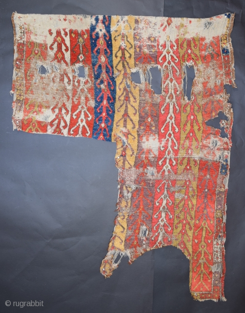 Konya-Cappadocia region, circa 1800, this is a recently discovered fragment of a battered, old and rare Anatolian weaving, we have displayed another portion of this rug in an earlier Rug Rabbit posting,  ...