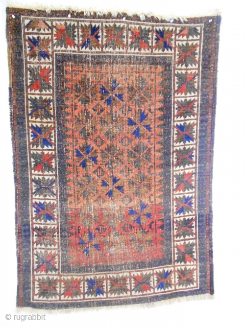 An extremely rare field design on a rug in the 'Baluch'-style. These rugs have been called Mushwani, Kurd-Baluch, Bahluri and Aimaq. The knots are symmetrical with significant warp displacement. The field composition  ...