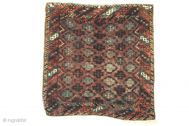 Baluch Bag Face, the design (both field and border) is classic among Baluch tribal groups, its unusual element is a rare greenish-blue color seen most vividly in the detail pictures. Unfortunately, the  ...