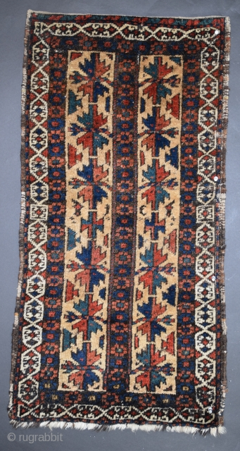 "Baluch balisht, 19"" x 36"", 48 x 91 cm, the pile is thick, the piece has a substantial feel, the weaver imaginatively incorporated several unusual variants to what would otherwise be a  ..."