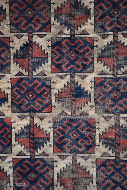 "Baluch rug, northeast Persia/northwest Afghanistan, 33"" x 57"", 83 x 144 cm, circa 1880, the field composition is an established member of the 'Baluch' design vocabulary, this design is, however, more commonly  ..."