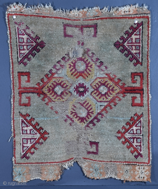 Central Anatolian yastic, circa 1900, battered by what was most likely genuine tribal wear, it has a less frequently encountered design, a mix of what appears to be both synthetic and natural  ...