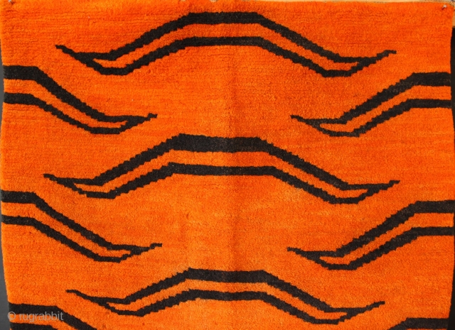 "Tibetan Tiger rug, circa 1930, 2'10"" x 5'6"". See Mimi Lipton for similar. In excellent pile with mild discolouration and a few spots of moth damage."