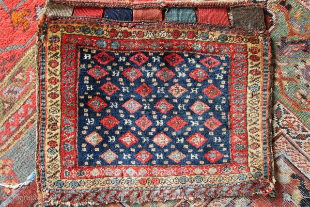 Kurdish bagface, full pile, beautiful patination and natural dyes. Several small holes.