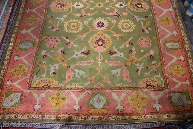 "A large green field 19th c Oushak carpet 11'9"" x 15'7"""