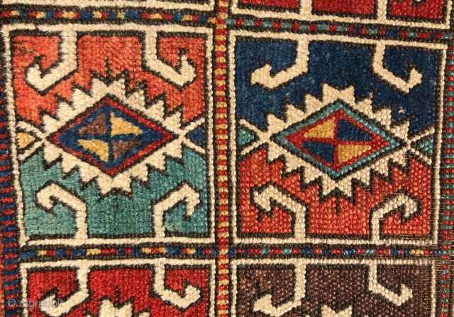 Northwest Anatolian Yastik. Outstanding colors, including blue, red, yellow, orange, turquoise blue, and aubergine, and nice wool.  Original selvedges and no repairs. Some loss to the ends and black corrosion. Last  ...