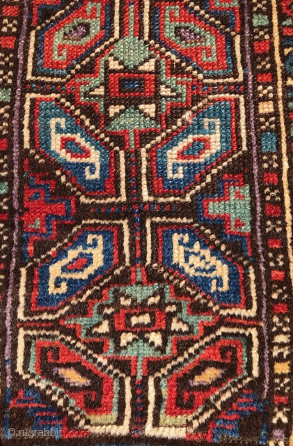 Turkish Yastik. Nice colors and drawing. Black is corroded. Soft wool and handle. No repairs. Mostly good pile, with some low areas and loss to ends. The single row of purple knots  ...