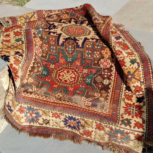 Antique Kuba Fragment.  Mid-19th? Fantastic dyes and wool. A highly displayable and forceful fragment, despite the abuses, including a small stain visible in photo 3.  Price befits the condition.