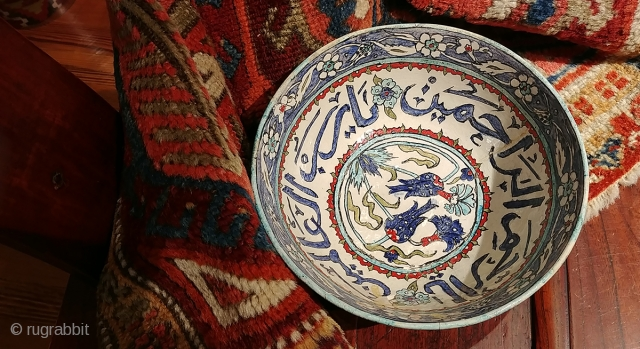 Old Turkish (Iznik?) bowl with calligraphic inscription.  Diameter 8.25 inches, 3.75 inches tall.  A crack and minor nick with old repair. Intact and stable,  Shows beautifully though fragile.   ...