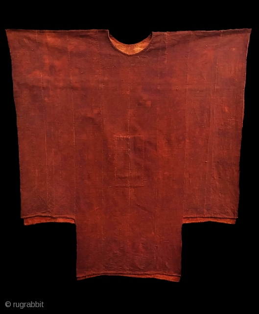 "West African kola-dyed, cotton tunic, probably from Mali. Mid 20th C?   Composed of narrow woven bands hand-stitched into a fabric.  For reference see ""Mali Mud Clothes"", in AFRICAN TEXTILES,  ..."