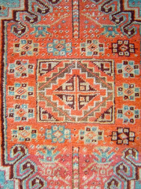 Sparkling little Anatolian yastik with rare gul and a mini=prayer design. Both madder and cochineal reds. Luminous silky angora-like wool. One end reduced, and so is the price.