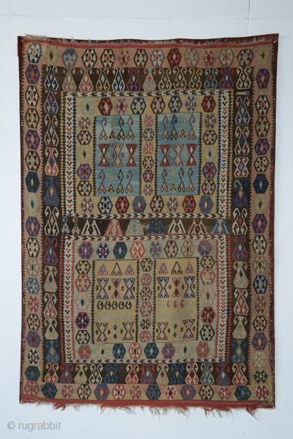 Anatolian kilim with 4 Rectangular compartments, 51 x 74 inches (130 x 188 cm). 19th century weaving with a layout and proportions resembling Turkmen ensis. Mounted on corduroy backing.