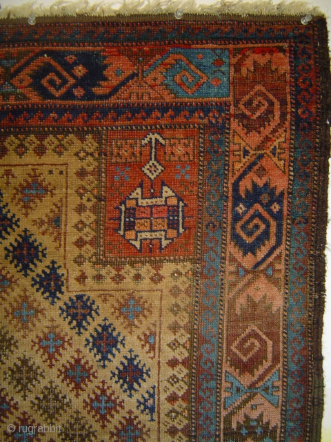 """Singular Baluch prayer rug, with 159 snowflake stars in a staggered repeat on the camel field. 34 x 54 inches. Each star contains a small """"cross le-boutonnee"""". Dramatic use of a sizzling  ..."""