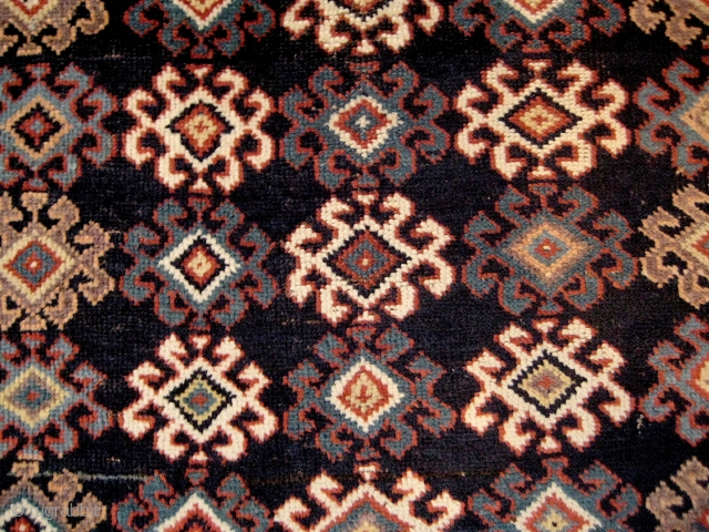 Elegant Luri rug, with attractive asymmetry in the field and good natural colours, including an unusual aubergine. Dense pile, with some small flaws, and side-cords that are a little worn. Probably late  ...