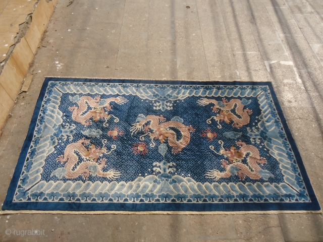 Chinese or Tibet Rug with Dragons,very nice rug with great colors and design,very soft shiny wool.Excellent condition.good age.Size 7'*4ft.E.mail for more info and pics.