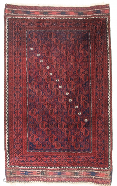 Antique Baluch rug, late 19th century. Boteh design with a diagonal line of white flowers, original weft work end finishes. Size: 153 x 93cm.