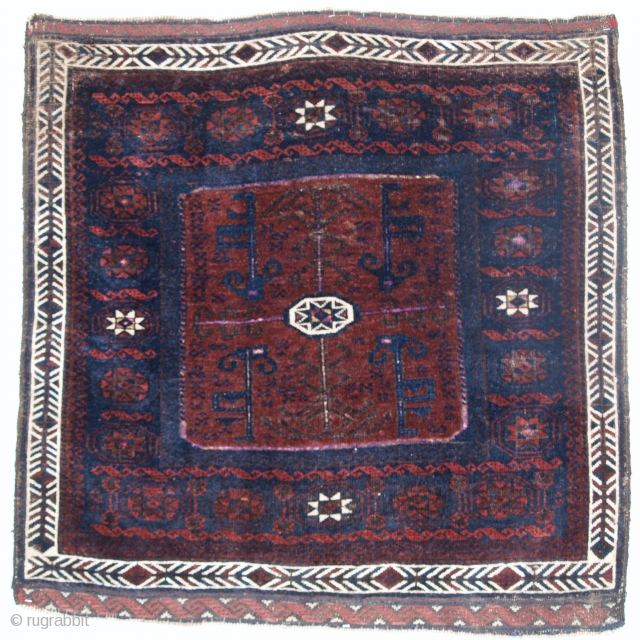 Antique Baluch bag face, 4th quarter 19th century, 'star in Octagon' design, silk highlights through out, decorative weft work end finishes, soft silky wool. Size: 91 x 89cm.