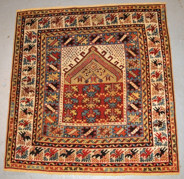 Antique Turkish Kozak village prayer rug of small size.  http://www.knightsantiques.co.uk/596157/antique-turkish-kozak-village-prayer-rug-small-square-size-scarce-item-2nd-half-19th-century/  2nd half 19th century.  Size: 3ft 7in x 3ft 5in (110 x 103cm).