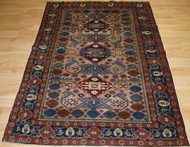 Antique Turkish Kayseri rug with traditional Caucasian 'Kuba' region design. Circa 1920. Size: 5ft 7in x 3ft 11in (170 x 120cm). The rug has a classic Caucasian design on a very soft ground colour with  ...