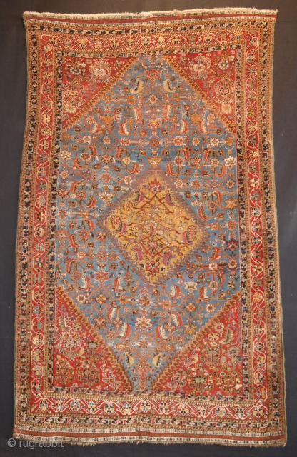 Fine Qashqai rug, sky blue field and yellow medallion. Size: 224 x 134cm.