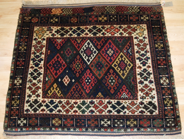 Persian Jaf Kurd bag face of diamond lattice design with good colour and superb wool. OLD JAF KURD BAG FACE WITH SCARCE IVORY GROUND BORDER, FULL PILE, EARLY 20TH CENTURY. Size: 3ft 1in x  ...