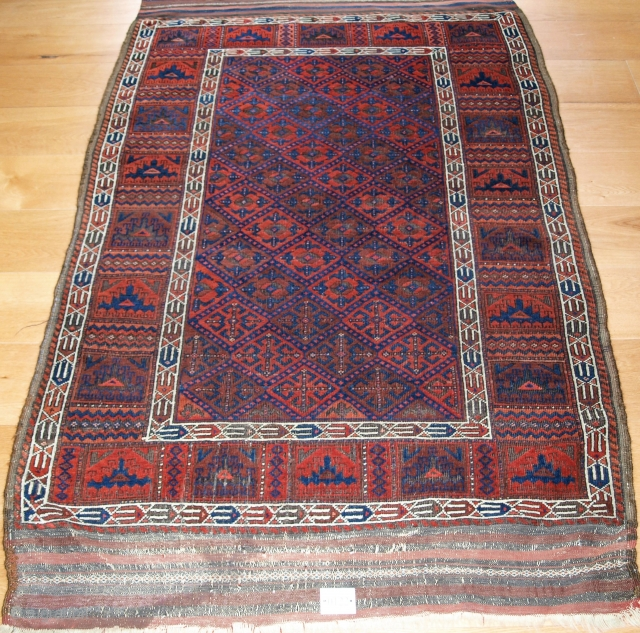 Antique Baluch rug from Western Afghanistan. A Baluch rug with outstanding colour in superb condition with a scarce design. Size: 6ft 2in x 3ft 10in (187 x 116cm).  2nd half 19th century.  The rug  ...