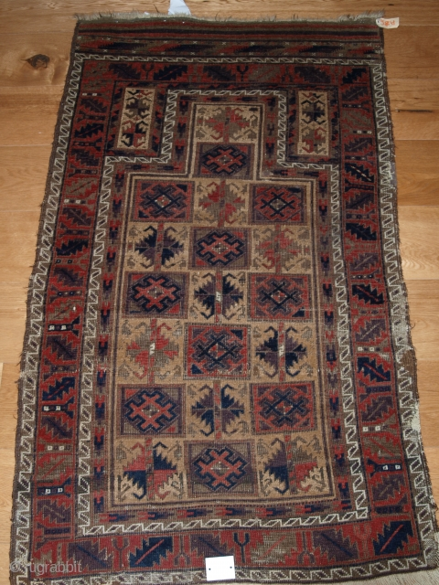 Camel ground Baluch prayer rug with 'box' design, original condition. Size: 141 x 85cm (4ft 8in x 2ft 9in).